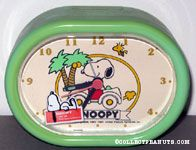 Snoopy driving VW Beetle with Woodstock and palm trees Alarm Clock