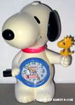Snoopy holding Woodstock and Tennis Racket Alarm Clock