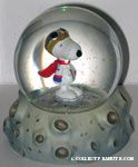 Astronaut Snoopy on cratered moon Snowglobe