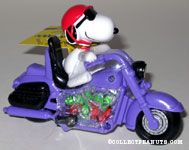 Joe Cool riding purple motorcycle 60th Anniversary Candy Container