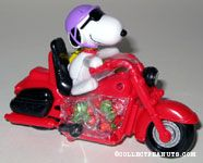 Joe Cool riding red motorcycle 60th Anniversary Candy Container