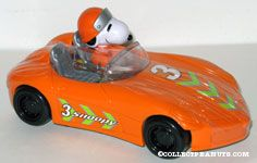 Snoopy driving orange racecar Candy Container