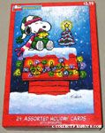 Snoopy & Woodstock bundled up on doghouse Christmas Cards