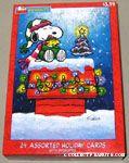 Snoopy & Woodstock bundled up on doghouse Christmas Cards
