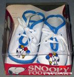 Snoopy handing balloons to Woodstock Baby Shoes