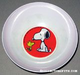 Snoopy sitting with Woodstock Bowl