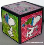 Snoopy scenes on cube Music box