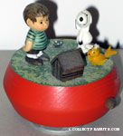 Snoopy , Woodstock and Linus standing around tiny doghouse Musicbox