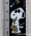 Snoopy playing saxophone with Woodstock on floating notes ruler
