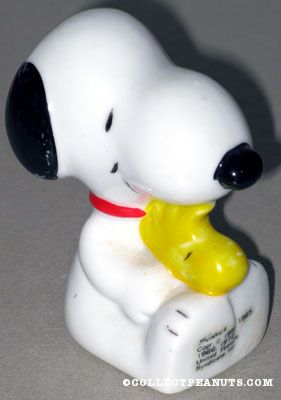 Snoopy sitting Holding Woodstock