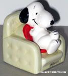 Snoopy sitting in armchair Ceramic Paperweight