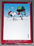 Snoopy looks at Woodstock's nest with stocking Assorted Christmas Cards