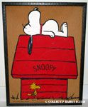 Snoopy laying on doghouse with Woodstock walking past Bulletin Cork Board