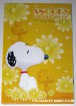 Snoopy & Woodstocks sitting with flowers Notepad