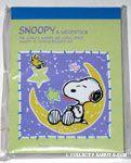 Snoopy sleeping on Moon Notepad