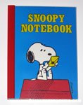 Snoopy looking at letter Notebook