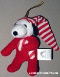 Snoopy wearing stocking cap and holding candy cane Plush Ornament
