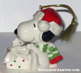 Snoopy and Woodstock opening Christmas Gift Ornament