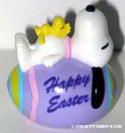 Snoopy & Woodstock laying on Easter Egg PVC Figurine - Purple