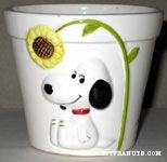 Snoopy sitting under flower Planter