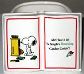 Snoopy looking at bookshelf Planter