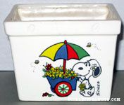 Snoopy pushing flower cart Planter