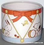 Snoopy & Woodstock scenes on drum-themed round Planter