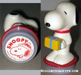 Snoopy holding gift package with Snoopy wearing hat Rubber Stamp Figure