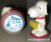 Snoopy holding gift package with Snoopy wearing baseball hat Rubber Stamp Figure