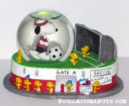 Snoopy and Woodstocks playing Soccer Snowglobe