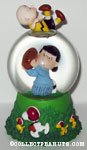 Lucy pulling football away from Charlie Brown Snowglobe