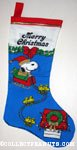 Santa Snoopy with sleigh drawn by Woodstocks Christmas Stocking