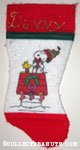 Snoopy hugging gift on doghouse with Woodstock Stocking