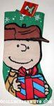 Charlie Brown holding gift Christmas Stocking