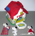 Stuffed house and Snoopy dolls