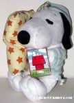 Snoopy wearing pajamas holding pillow Plush