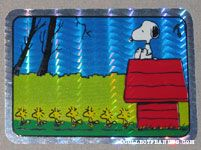 Snoopy on doghouse with line of Woodstocks Prismatic Photo/Trading Card