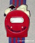 Snoopy lying on top of watch bezel