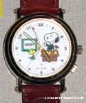 Snoopy standing behind desk with Woodstock Watch