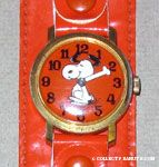 Snoopy dancing on orange Face with orange snap band