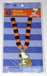 Snoopy looking at Pumpkin Foam Jewelry Kit