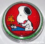 Snoopy at typewriter with Woodstock glass dome Paperweight