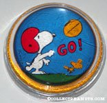 Snoopy and Woodstock playing Football glass dome Paperweight
