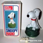 Snoopy sitting on grass Radio