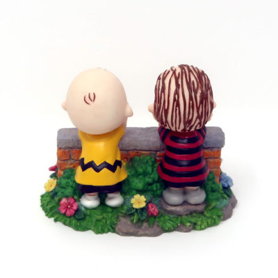 Linus and Charlie Brown leaning on wall Figurine