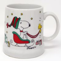Snoopy driving sleigh led by Woodstock Stein