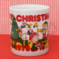 Peanuts Gang opening gifts around Christmas tree Mug