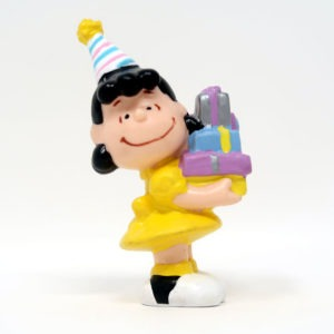 Lucy holding stack of gifts PVC Figurine