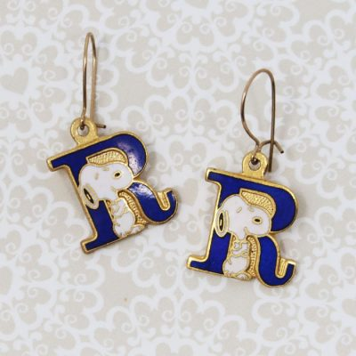 Snoopy standing next to the letter R Earrings