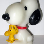 Snoopy sitting with Woodstock Candle